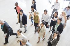 High angle view of business people walking in office - stock photo