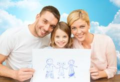 happy family with drawing or picture - stock photo
