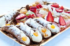Typical sweet Italian consist cannoli , baba and pastries - stock photo