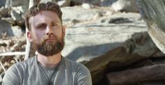 Jib Down To Bearded man in Woods 4K Stock Footage