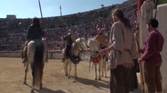 Roman gladiators on horseback in arena Stock Footage