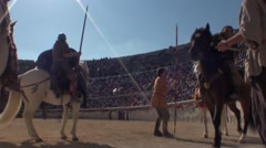 Roman gladiators on horseback in arena 1 Stock Footage