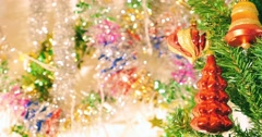 Close up footage of a Christmas tree and some decorations in the background Stock Footage