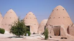 Beehive houses in the village of Sarouj. Syria - stock photo
