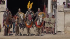 Roman gladiators on horseback in arena 2 Stock Footage