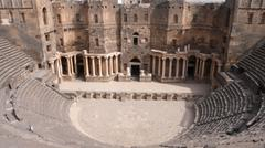 Citadel and Roman Theatre of Bosra in Syria  Stock Photos