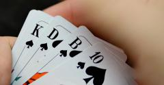 A person reveals his cards, he has got a flush - stock footage