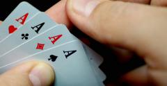 A person reveals his cards, he has got four aces - stock footage