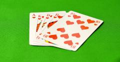 A poker player puts his cards on the table - he has got a royal flush - stock footage
