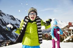 Siblings having snowball fight Kuvituskuvat