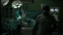 Surgical team using c-look, monitor, medical apparatus for hip surgery operation Stock Footage