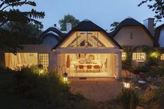 Open modern house illuminated at night - stock photo