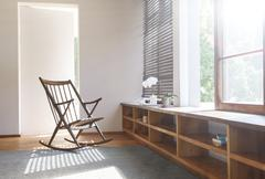 Rocking chair and rug in modern bedroom Stock Photos