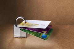 Credit cards attached to padlock Stock Photos