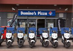 Domino's pizza store in the hague with scooters in the front - stock photo