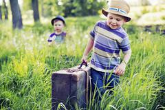Two litle brothers starting the journey - stock photo