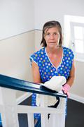woman cleaning banisters - stock photo