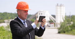 Businessman Cement Factory Manager Planning Manufacture Activity Using Tablet Stock Footage