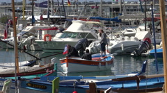 People in small boat leave moorings, Nice port and marina, France - stock footage