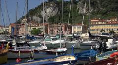 Small fishing boat motors past, Nice port and marina, France Stock Footage