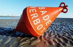 Buoy - bathing prohibition / Boje Norsee - Baden verboten Stock Photos