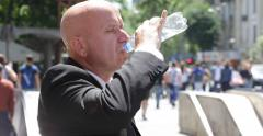 People Crowded City Center Street Hot Sunny Day Thirsted Salesman Drink Water Stock Footage