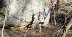 Male Trail Runner Past Large Boulder Slow Motion 4K Stock Footage