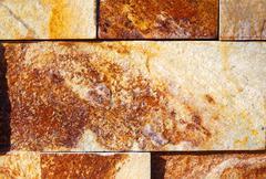 Rock Wall Texture. Ocher background. Stock Photos