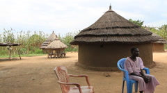 South Sudanese Women and Rural Village Hut Stock Footage