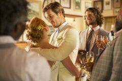 Bridegroom embracing bride during wedding reception in domestic room Stock Photos