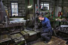 Drilling of steel parts in  turning shop metal factories. Stock Photos