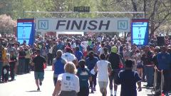 RUNNERS HEAD TO FINISH LINE Stock Footage