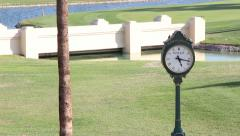 Clock on Golf Course (Oversized Rolex Clock) - stock footage