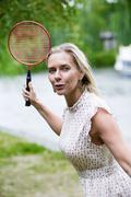 woman playing badminton - stock photo