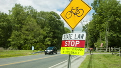 Crosswalk for pedestrians and cyclists, bike path, road safety sign Stock Footage