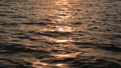 Ocean sunset surface reflection Stock Footage