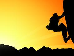 Silhouette of climbing young adult at the top of summit - stock photo