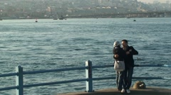 Couple in love hug on Eminonu Galata Bridge Stock Footage