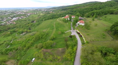Aerial view of houses in forest of mount Medvednica, with cityscape in distance. Stock Footage