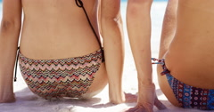 Rear view close up beautiful young woman wiping beach sand off ass wearing - stock footage