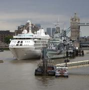 Cruise ship berthed next to HMS belfast on the River Thames London Uk Stock Photos
