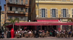 People sit at restaurant in Cours Salaya old town, Nice, France Stock Footage
