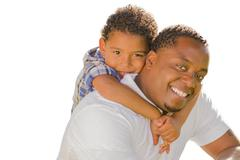 Mixed Race Father and Son Playing Piggyback On White - stock photo
