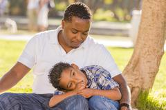 African American Father Worried About His Mixed Race Son Kuvituskuvat