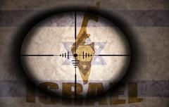 Sniper scope aimed at the vintage israeli flag and map Stock Illustration
