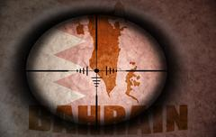 sniper scope aimed at the vintage bahrain flag and map - stock illustration