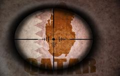 sniper scope aimed at the vintage qatar flag and map - stock illustration