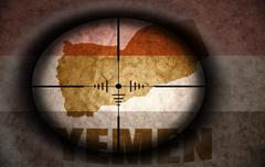 sniper scope aimed at the vintage yemeni flag and map - stock illustration