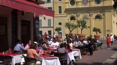 People sit at tables at restaurant in Cours Salaya old town, Nice, France - stock footage