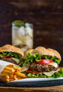Homemade Hamburger with Fresh Vegetables and Drink with Ice Stock Photos